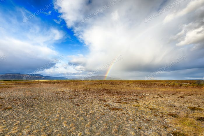 Gorgeous Icelandic stormy landscape with rainbow.