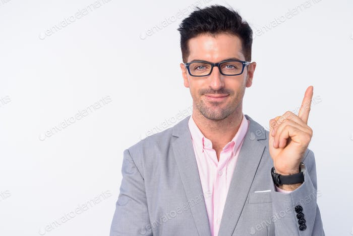 Face of young handsome businessman with eyeglasses pointing up
