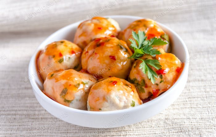 Chicken meatballs with parmesan under spicy sauce