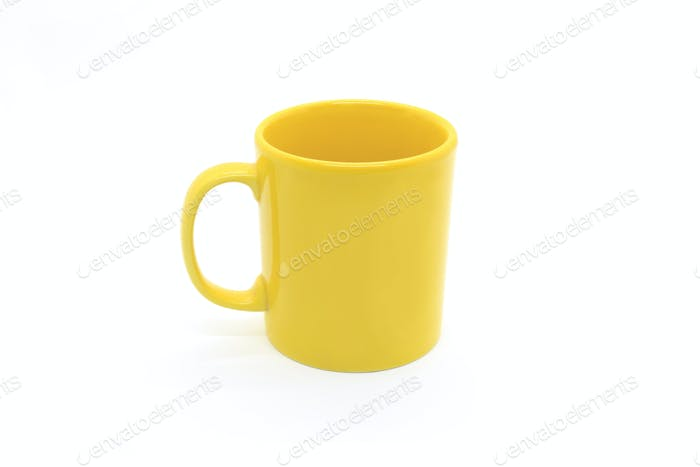 Bright yellow ceramic cup on white background
