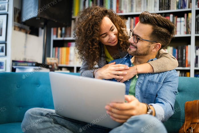 Students are studying together in library. Couple, study, technology, education love concept