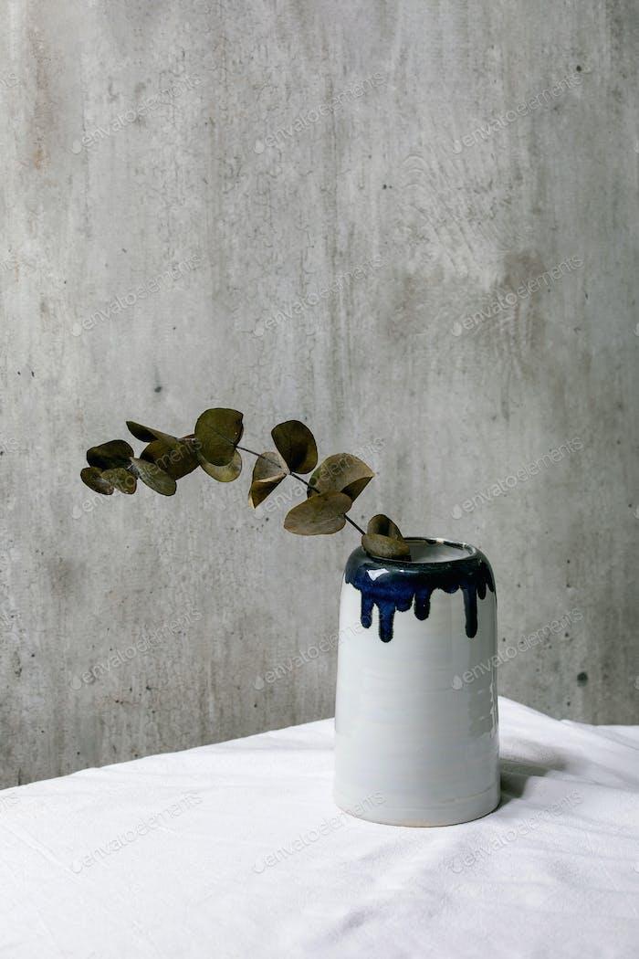 Ceramic vase with eucalyptus