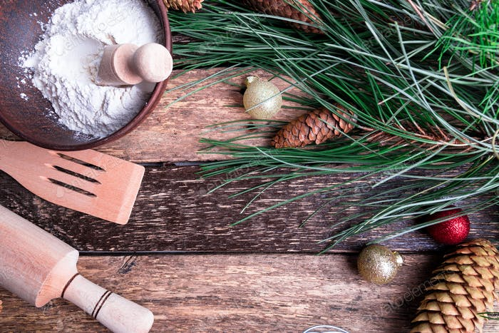 Ingredients for cooking Christmas baking on wooden background. Top view, copy space. Flat lay