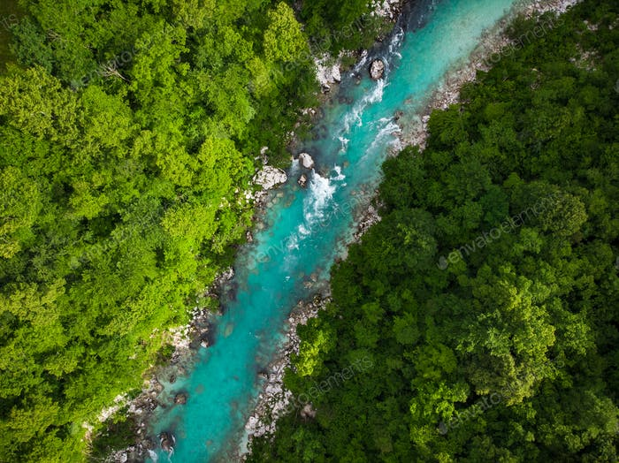 Emerald green Soca river in Slovenia, top down aerial photo
