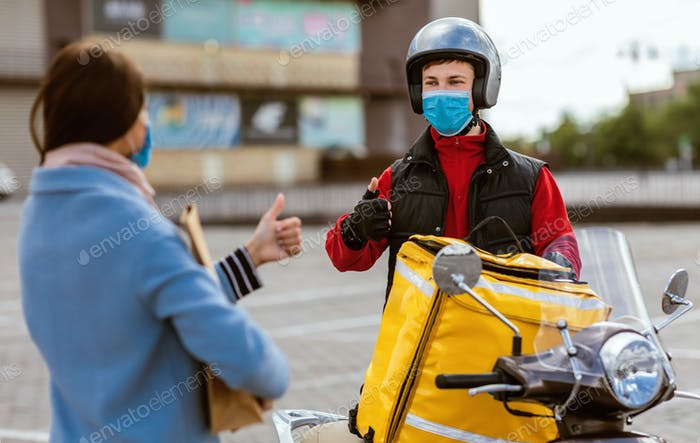 Cheerful Courier And Customer Girl Gesturing Thumbs Up Standing Outside