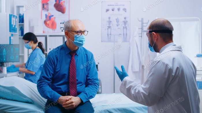 Senior man at doctor appointment during COVID-19