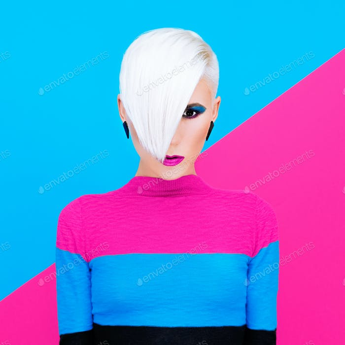 Fashion blond model with trendy hairstyle and make-up on a color