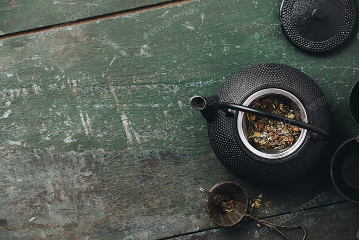 Tea composition flat lay, Teapot with dry tea leaves, Making tea