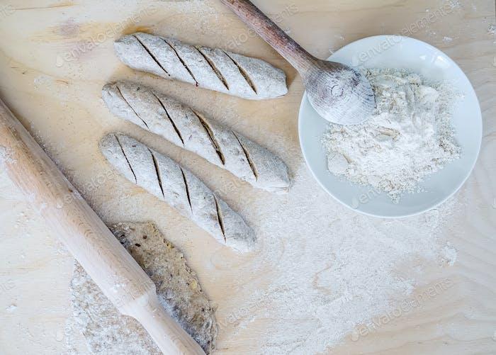 Homemade baguette cooking process: full grane dough, a rolling p