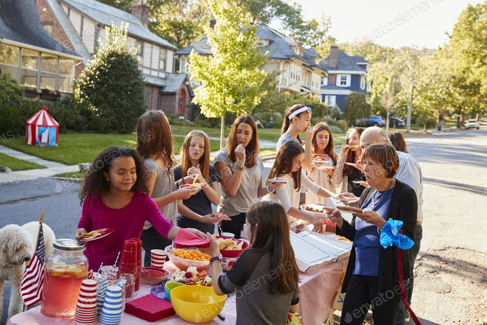 Neighbours helping themselves to food at a block party