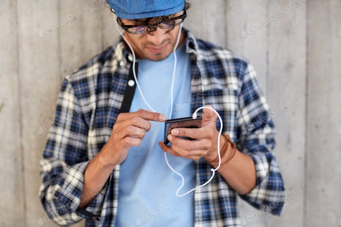 man with earphones and smartphone listening music