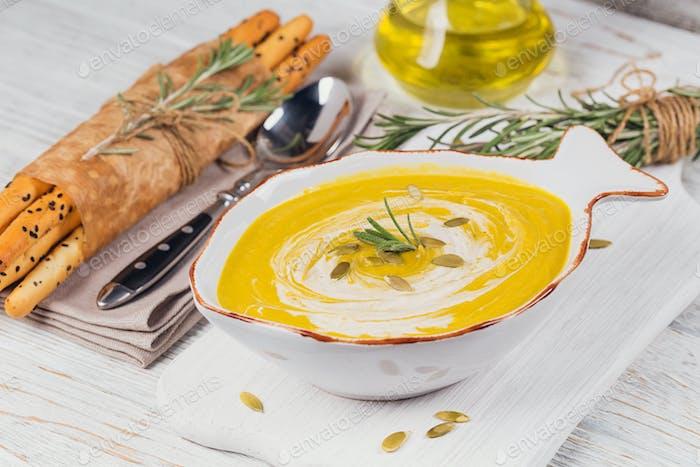 Pumpkin soup with cream and pumpkin seeds