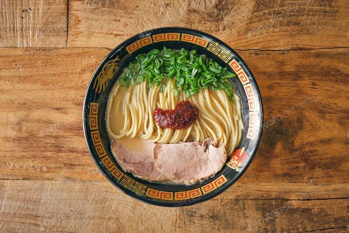 Tasty ramen with pork slices and salsa