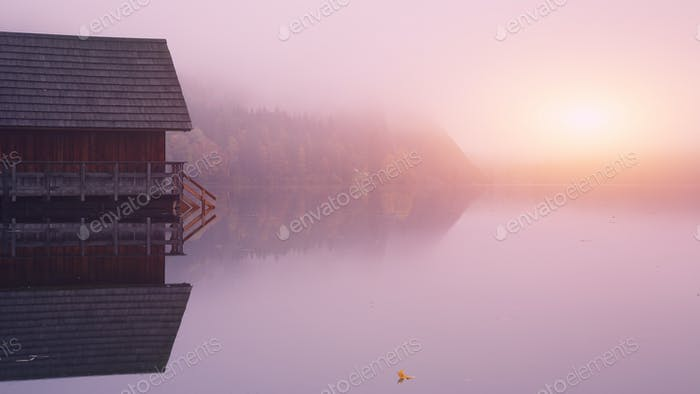 Misty sunrise on a lake Altausseer
