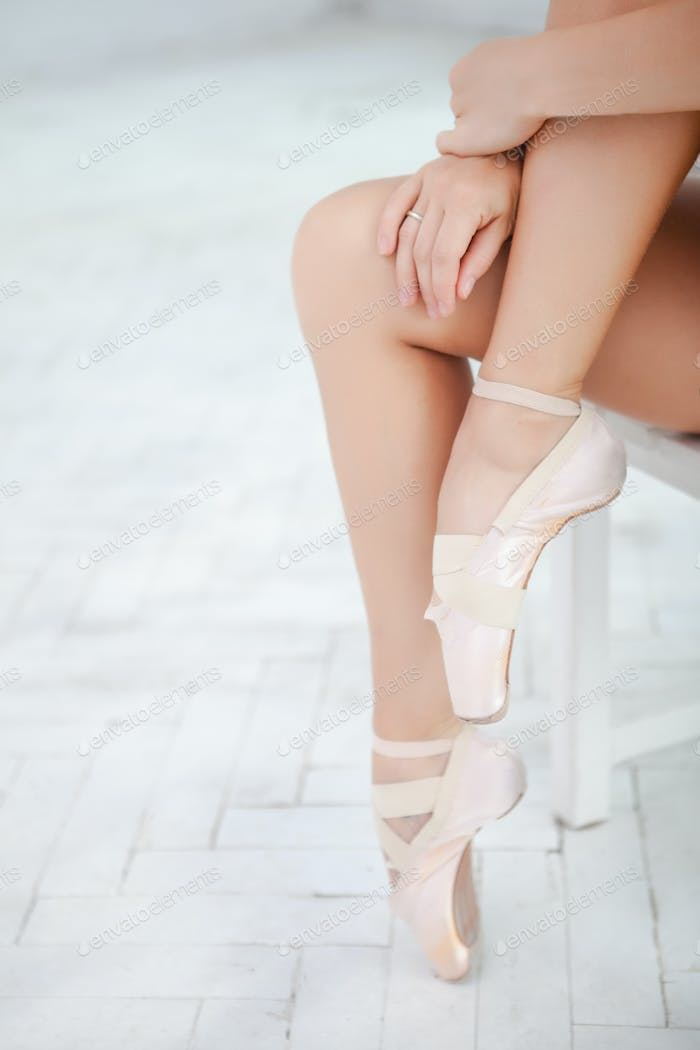 the legs of a ballerina on white background