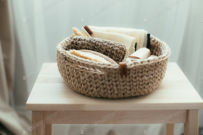 Natural product in jude basket. Bodybrush, toothbrush, shopping bag, soap. Treat yourself concept