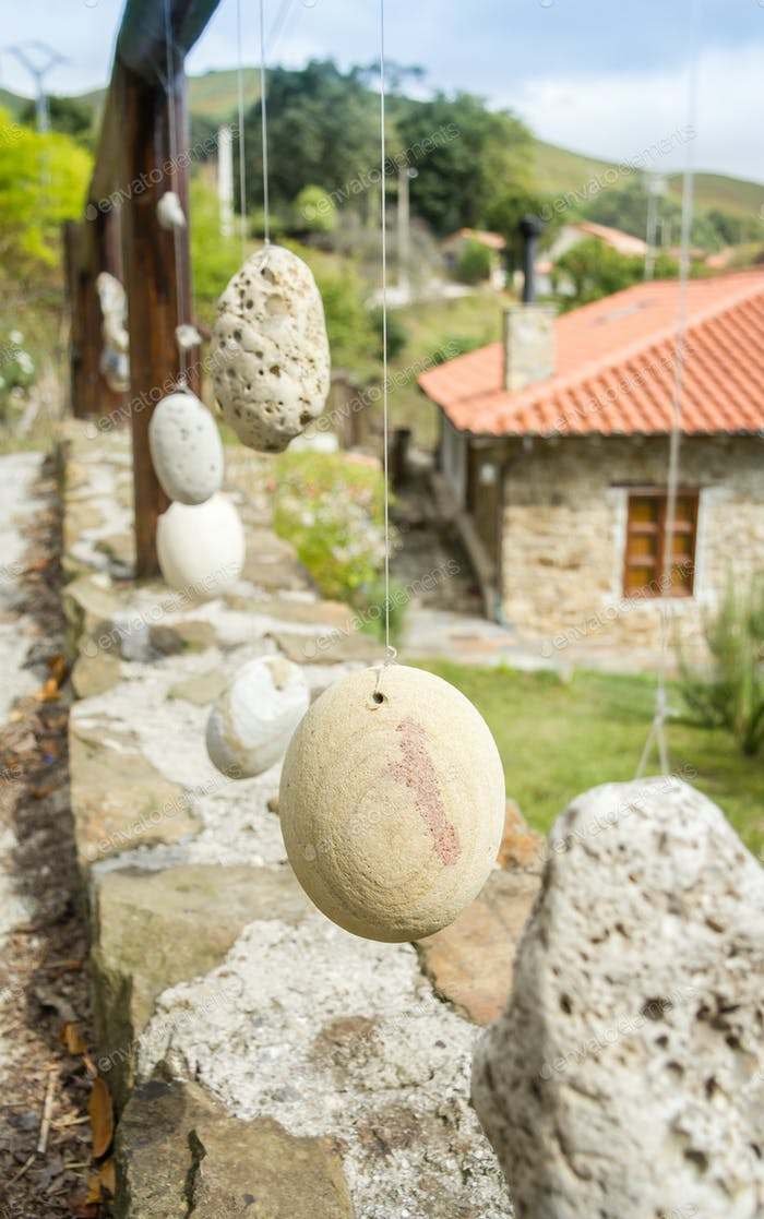Wooden railing with hanged stones