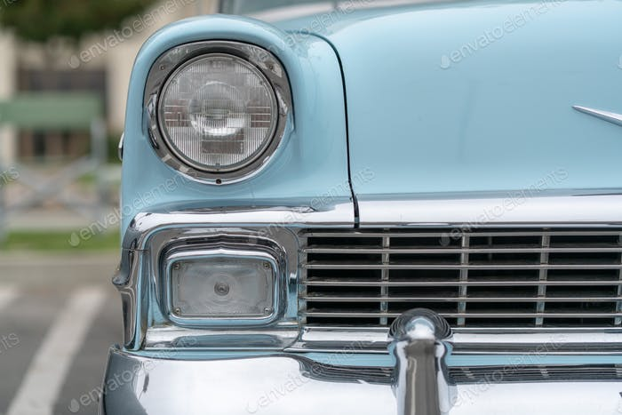 Close up of vintage blue car bumper and lamps