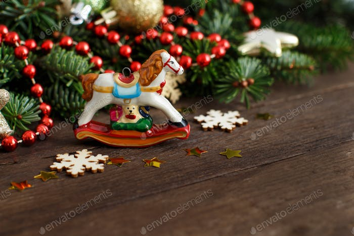 festive decorations with rocking horse and christmas decoration