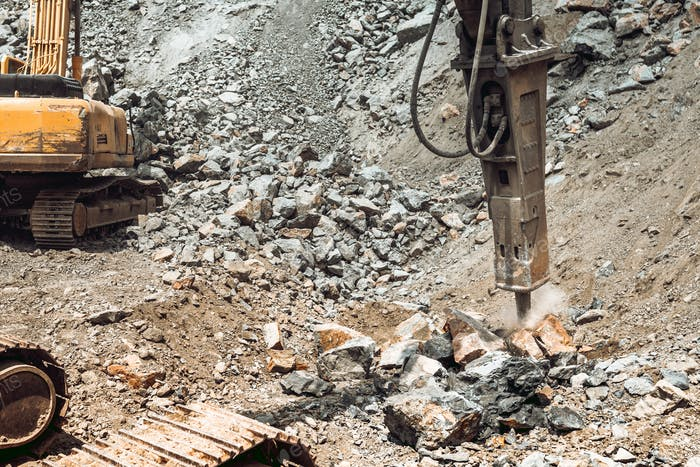 track type excavator and bulldozer working on construction site