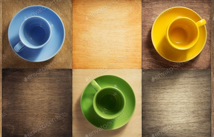 empty cup and saucer at wooden background