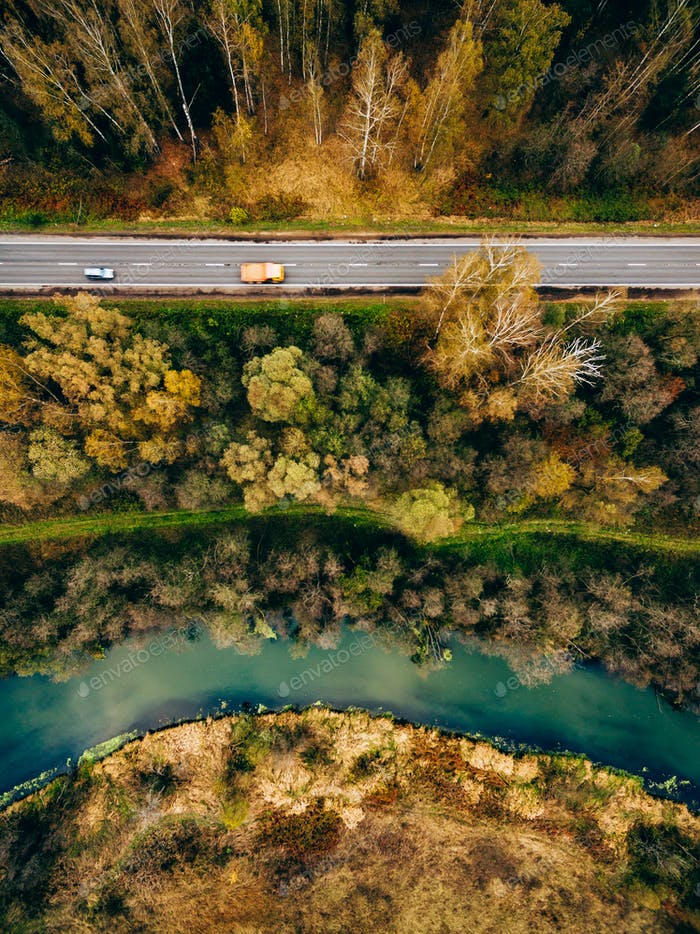 Aerial view of river and road in autumn color forest