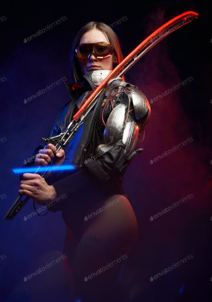 Dangerous female assassin from the future posing in dark background