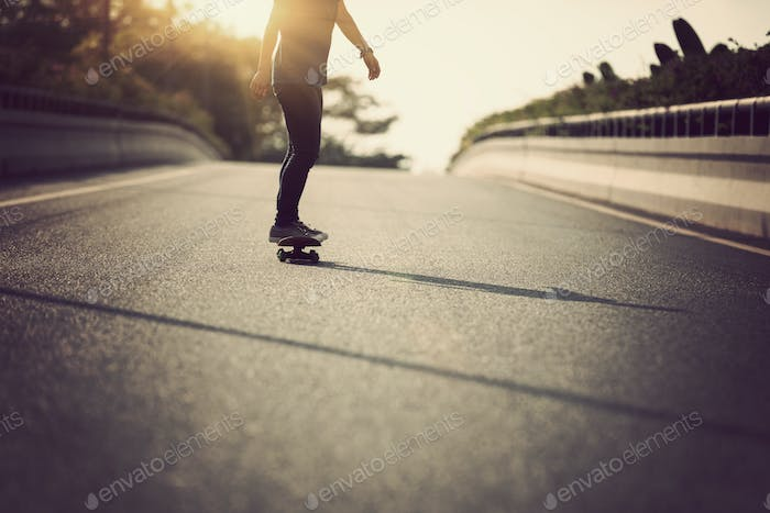 skateboarding on driving road
