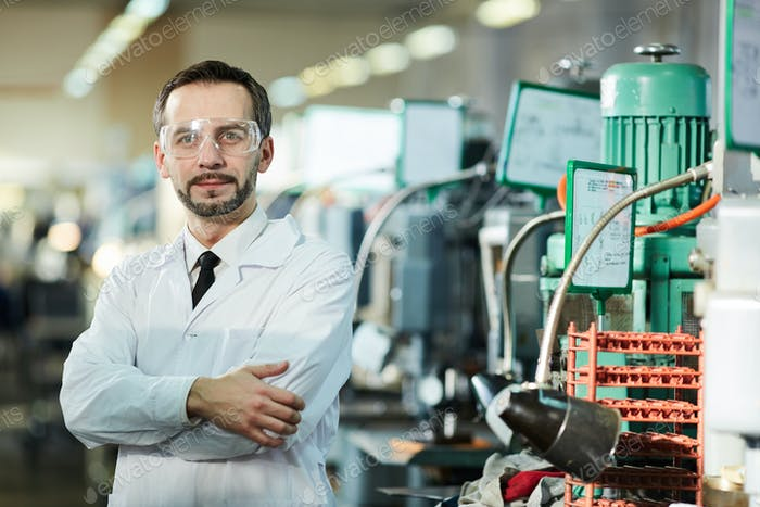 Mature Factory Worker Wearing Lab Coat
