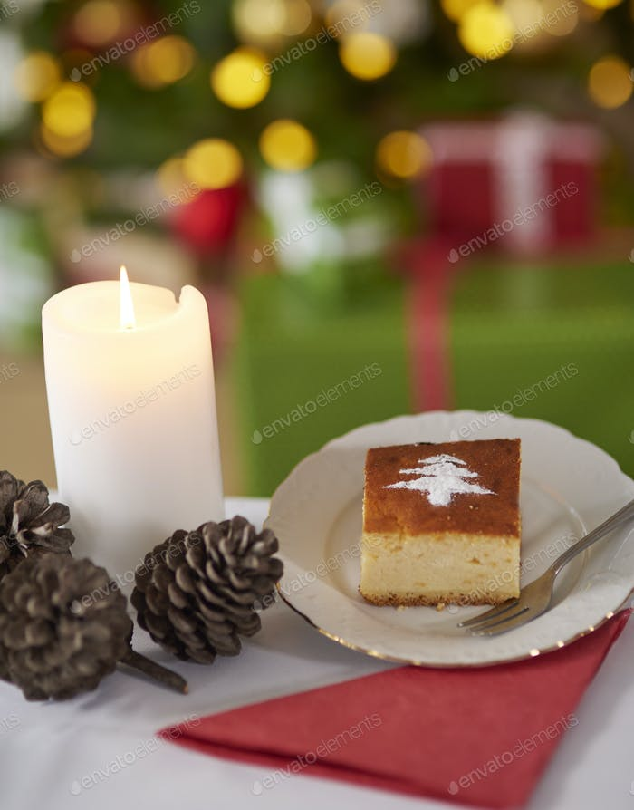 Sweet cake and Christmas tree in the background