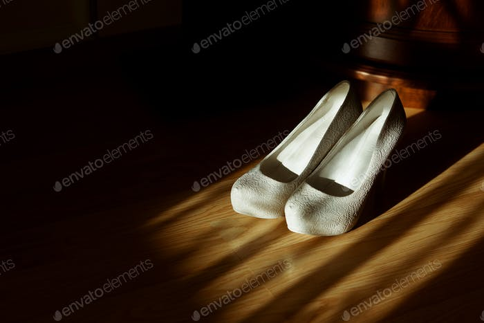 luxury wedding shoes on heels in the room at morning getting ready