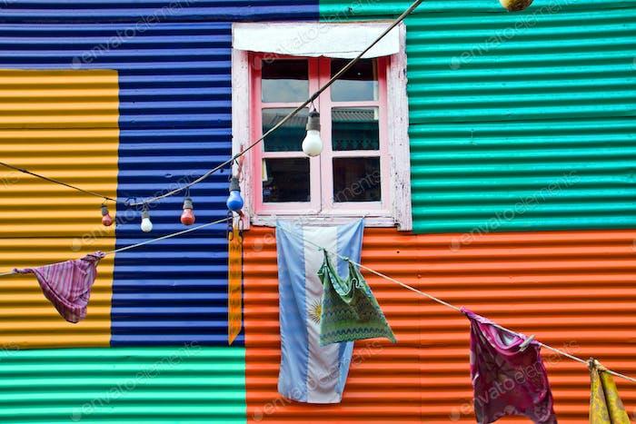 Colourful window with laundry in La Boca