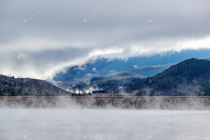 Foggy misty lake landscape in Colorado, USA