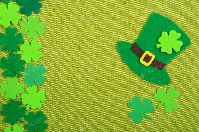 Flat lay Happy St. Patrick's background mockup of handmade felt shamrock clover leaves