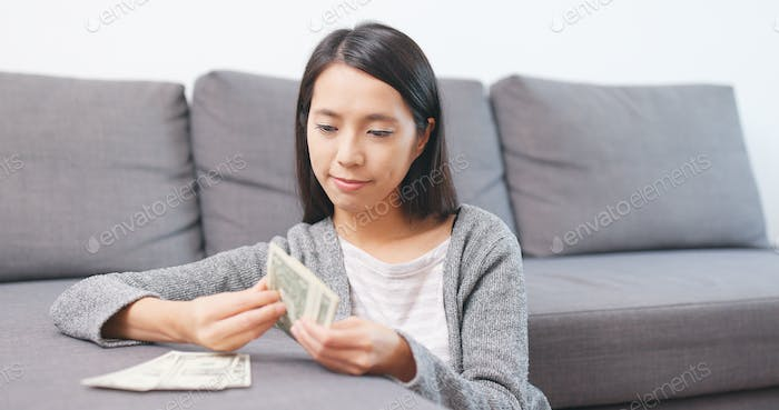 Woman counting money banknote