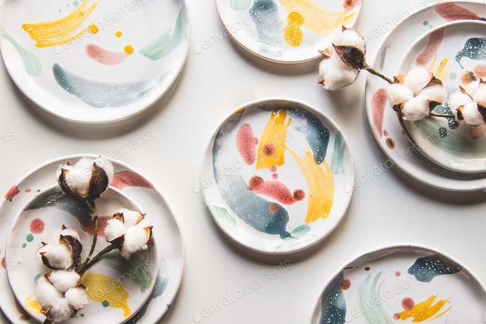 Hand-painted ceramic plates. Collection of colorful ceramic on white background