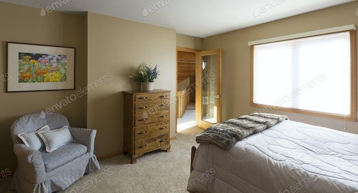54693,Armchair and dresser in bedroom