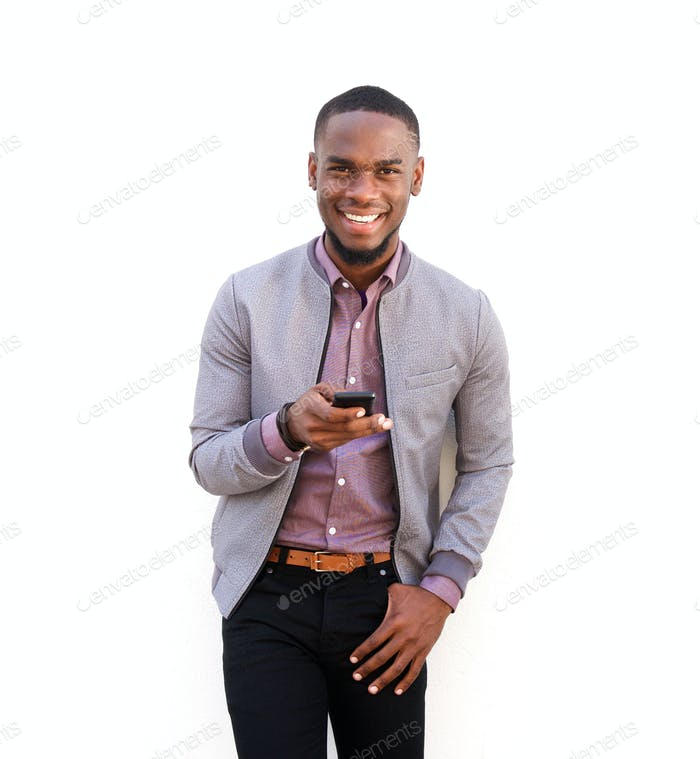 Handsome young african man standing with a mobile phone
