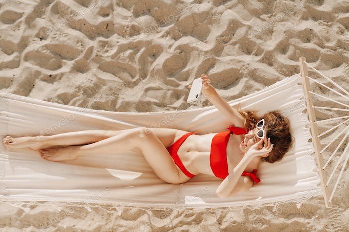 Pretty young woman relaxing in a hammock