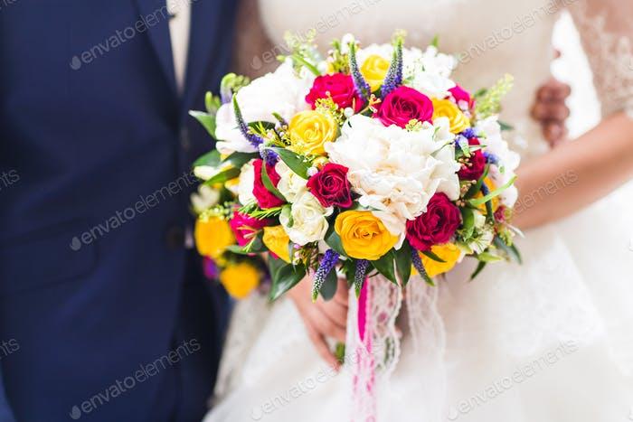 beautiful bouquet  in the hands of  bride