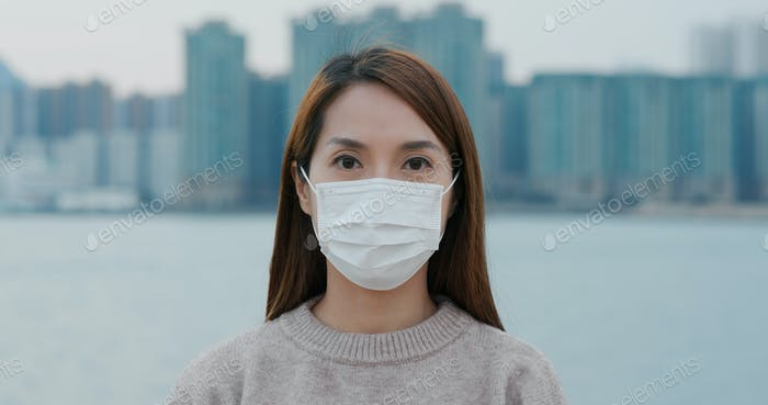 Woman wears the face mask