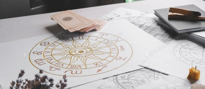Astrology. Astrologer calculates  natal chart and makes a forecast of fateTarot cards