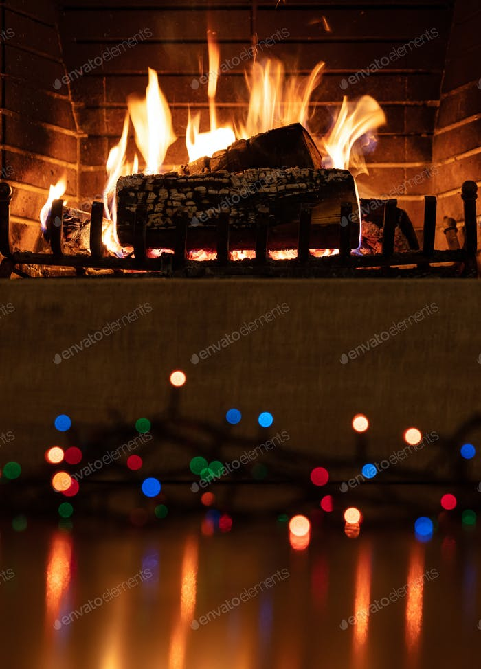 Christmas burning fireplace and lights, holiday decoration background