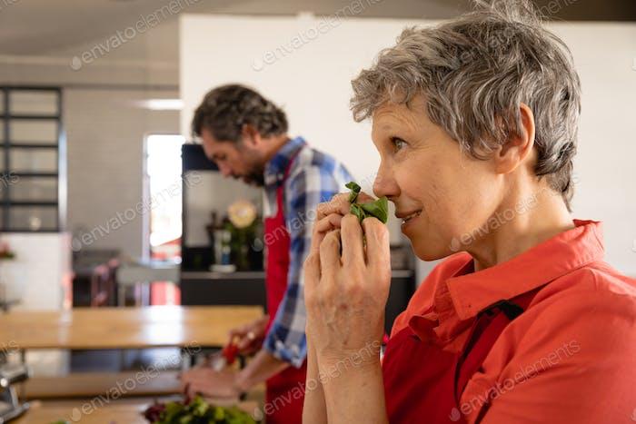 Chef smelling salad