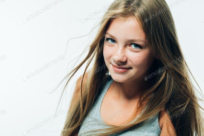 Beautiful teenager girl model freckles long hair portrait