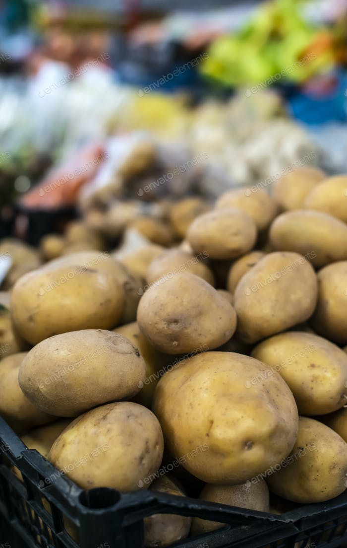 Potatoes in cate on the market.