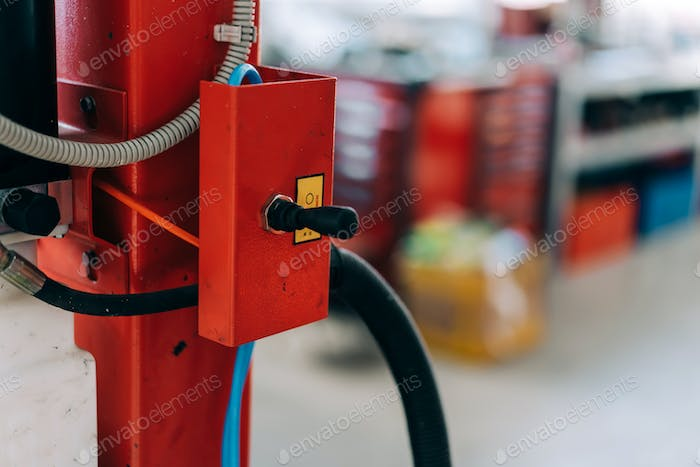 Car lift standing at the service station. Car repair equipment