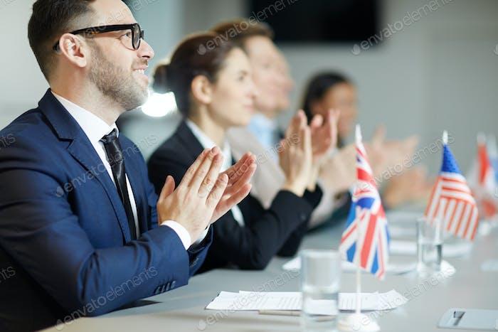 Applauding after speech