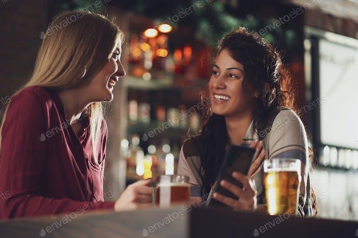Girlfriends in bar