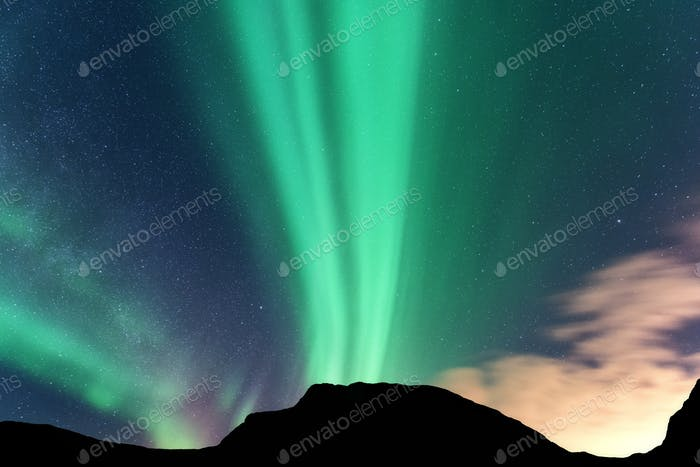 Aurora borealis and silhouette of mountains. Lofoten islands, No